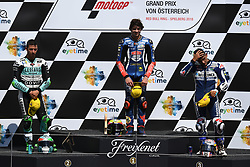August 12, 2018 - Spielberg, Austria - 12 Italian driver Marco Bezzecchi of Team Pruestl GP,  33 Italian driver Enea Bastianini of Team Leopard Racing and  88 Spanish driver Jorge Martin of Team Del Conca Gresini during podium ceremony of Austrian MotoGP grand prix in Red Bull Ring  in Spielberg, on August 12, 2018. (Credit Image: © Andrea Diodato/NurPhoto via ZUMA Press)