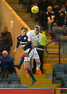 Dundee&rsquo;s Danny Williams and Partick Thistle&rsquo;s Christie Elliot in aerial action - Dundee v Partick Thistle in the Ladbrokes Scottish Premiership at Dens Park, Dundee. Photo: David Young<br /> <br />  - &copy; David Young - www.davidyoungphoto.co.uk - email: davidyoungphoto@gmail.com