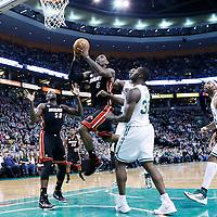 27 January 2013: Miami Heat small forward LeBron James (6) goes for the layup past Boston Celtics power forward Jeff Green (8) and Boston Celtics power forward Brandon Bass (30) during the Boston Celtics 100-98  2OT victory over the Miami Heat at the TD Garden, Boston, Massachusetts, USA.