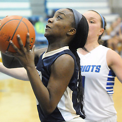 Staff photos by Tom Kelly IV<br /> Rustin's Noelle Powell (22) drives toward the hoop for a layup with Great Valley's Brittany Powell (1) in pursuit during the West Chester Rustin at Great Valley girls basketball game on Thursday night, January 9, 2014.