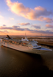 Cruise liner departing at sunset