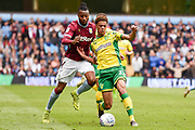 Aston Villa striker Jonathan Kodjia (26) battles for possession  with Norwich City defender Jamal Lewis (12) during the EFL Sky Bet Championship match between Aston Villa and Norwich City at Villa Park, Birmingham, England on 5 May 2019.