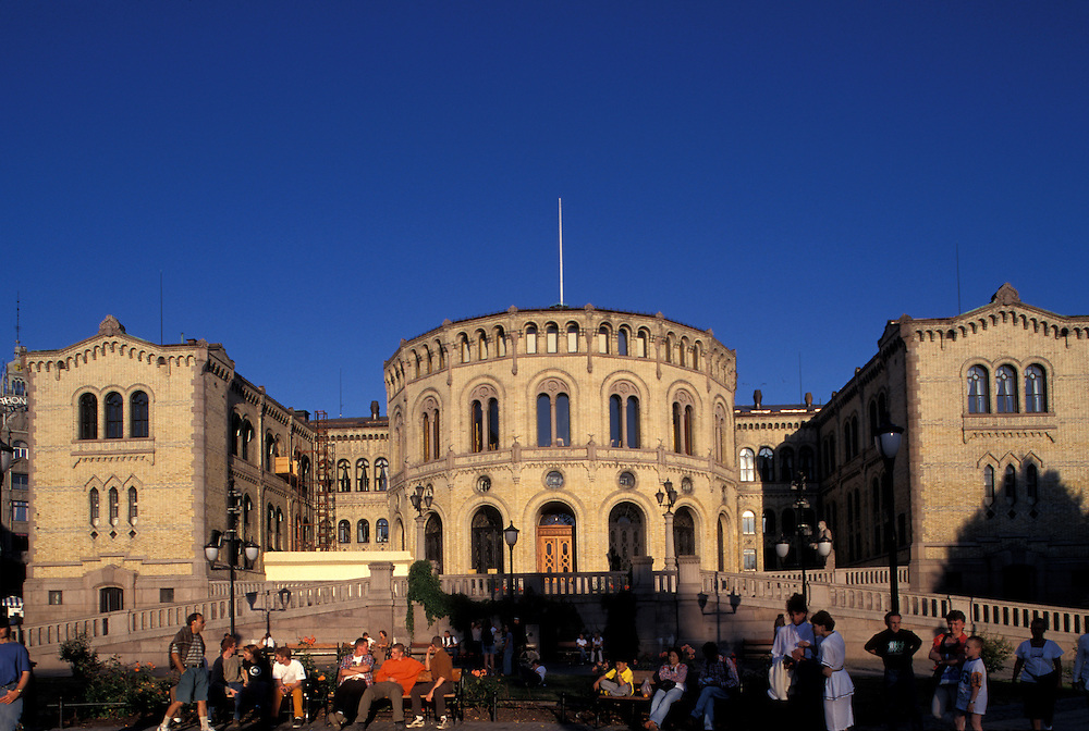 Europe, Norway. The Stortinget (Parliament) lit by setting sun along Karl Johans Gate