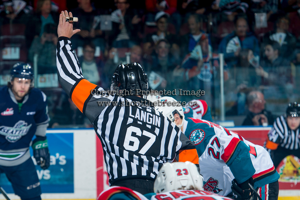 KELOWNA, CANADA - APRIL 26: Referee Mike Langin stands at centre ice between the Kelowna Rockets and theSeattle Thunderbirds on April 26, 2017 at Prospera Place in Kelowna, British Columbia, Canada.  (Photo by Marissa Baecker/Shoot the Breeze)  *** Local Caption ***