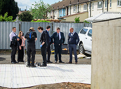 © Licensed to London News Pictures. 16/05/2017. London, UK. A team of detectives watch over an area being scanned, as the search continues for the body of murdered schoolgirl Danielle Jones at a block of garages in Stifford Clays in Thurrock, Essex. The 15-year-old was last seen on Monday June 18 2001 at about 8am when she left her home in East Tilbury to catch the bus to school.  Photo credit: Ben Cawthra/LNP