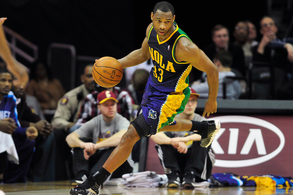 March 6, 2011; Cleveland, OH, USA; New Orleans Hornets shooting guard Willie Green (33) drives down court during the fourth quarter against the Cleveland Cavaliers at Quicken Loans Arena. The Hornets beat the Cavaliers 96-81. Mandatory Credit: Jason Miller-US PRESSWIRE