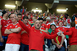LILLE, FRANCE - Friday, July 1, 2016: Wales supporters cheer in the stands ahead of the UEFA Euro 2016 Championship Quarter-Final match against Belgium at the Stade Pierre Mauroy. (Pic by Paul Greenwood/Propaganda)