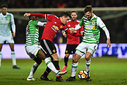 Ander Herrera (21) of Manchester United battles for possession with Francois Zoko (13) of Yeovil Town and Lewis Wing (6) of Yeovil Town during the The FA Cup 4th round match between Yeovil Town and Manchester United at Huish Park, Yeovil, England on 26 January 2018. Photo by Graham Hunt.