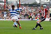 Brentford Midfielder Lewis Macleod (4) gets a cross in to the box during the EFL Sky Bet Championship match between Brentford and Queens Park Rangers at Griffin Park, London, England on 21 April 2018. Picture by Andy Walter.