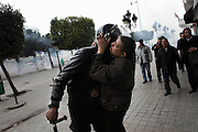 A protester kisses a policeman during a  demonstration in the center of Tunis .People still protest against the partecipation of the Constitutional Democratic Rally, RCD, party of Ben Ali, to the national unity government that today january 18 lost three ministers of the opposition.