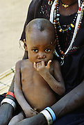 Young child with its mother in Burkina Faso, formerly Upper Volta, Africa.
