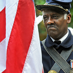 Photos by Tom Kelly IV<br /> Albert El, a member of the 3rd Regiment Infantry of the United State Colored Troops, a group of Civl War reenactors, salutes the flag during the playing of the National Anthem, during the dedication of the Frederick Douglass statue at West Chester University, Tuesday afternoon October 1, 2013.