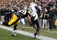 15 NOVEMBER 2008: Purdue wide receiver Greg Orton (21) catches a 8 yard touchdown pass and keeps a foot inbounds in front of Iowa linebacker A.J. Edds (49) in the second half of an NCAA college football game against Purdue, at Kinnick Stadium in Iowa City, Iowa on Saturday Nov. 15, 2008. Iowa beat Purdue 22-17.