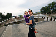 "LONGMONT, CO - SEPTEMBER 13: Samantha Kinzig, of Longmont, Colorado, and her five year-old daughter Isabel take in closer view of a damaged bridge on Weld County Road 1 in Longmont, Colorado as heavy rains for the better part of week fueled widespread flooding in numerous Colorado towns on September 13, 2013. Kinzig is a Colorado native and said she's never seen anything like this adding, ""this is amazing to me"". (Photo by Marc Piscotty/ © 2013)"