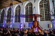 DORDRECHT - Koning Willem-Alexander leest een passage uit de Statenbijbel voor tijdens de viering dat de Synode van Dordrecht 400 jaar geleden plaatsvond. ANP ROYAL IMAGES ROBIN UTRECHT **NETHERLANDS ONLY**