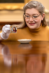 The Bonham's Home &amp; Interiors Sale takes place on 21-22 February and features  a wide array of silver and porcelain.<br /> <br /> Pictured: Jaine Heggie  of Bonhams with a Naples Poulard Prad Portrait cup and saucer