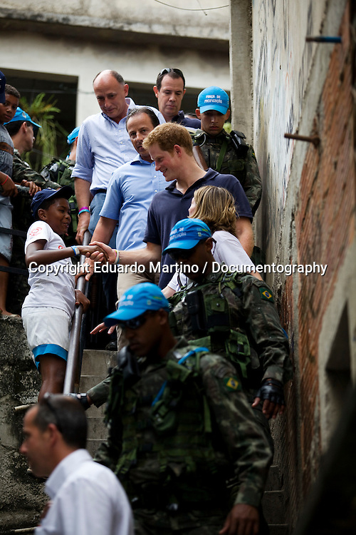 Prince Harry visited the Alemão Favela in Rio de Janeiro, where he saw firsthand the difference Sport Relief money can make. Prince Harry opened a new community centre in the Favela which is being funded by money raised through Sport Relief. .Photo: Eduardo Martino / documentography.10.03.2012
