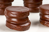 Close up of chocolate cookie, also a traditional argentiean sweet, called alfajor covered with chocolate.