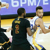 12 June 2017: Cleveland Cavaliers guard Kyle Korver (26) and Cleveland Cavaliers guard Kyrie Irving (2) defend on Golden State Warriors guard Stephen Curry (30) during the Golden State Warriors 129-120 victory over the Cleveland Cavaliers, in game 5 of the 2017 NBA Finals, at the Oracle Arena, Oakland, California, USA.