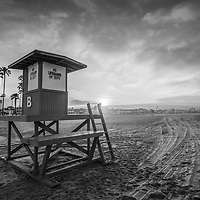 Newport Beach California Lifeguard Tower B sunrise black and white photo.  Newport Beach is a popular coastal beach city along the Pacific Ocean in Southern California. Photo is high resolution. Copyright ⓒ 2017 Paul Velgos with All Rights Reserved.