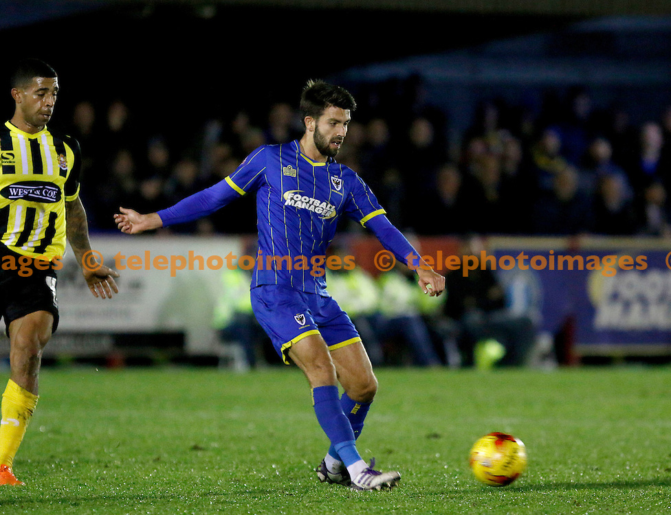 George Francomb of AFC Wimbledon on the ball during the Sky Bet League 2 match between AFC Wimbledon and Dagenham and Redbridge at the Cherry Red Records Stadium in Kingston. November 24, 2015.<br /> Carlton Myrie / Telephoto Images<br /> +44 7967 642437