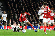 Djed Spence (29) of Middlesbrough is fouled by Kevin McDonald (6) of Fulham during the EFL Sky Bet Championship match between Fulham and Middlesbrough at Craven Cottage, London, England on 17 January 2020.