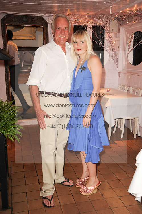 "JOHN RENDALL and his daughter TALLULAH RENDALL at a party to celebrate the publication of the Paper back edition of ""A Lion Called Christian"" held at Julie's Restaurant & Bar, 135 Portland Road, London W11 on 28th June 2010."