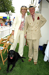 SIR BENJAMIN SLADE and MISS KIRSTEN HUGHES with his dog Jasper at the Macmillan Cancer Relief Dog Day held at the Royal Hospital Chelsea South Grounds, London on 6th July 2004.
