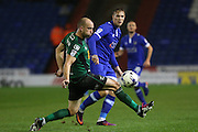 Lee Erwin of Oldham Athletic tries a through pass under pressure from Scunthorpe United defender David Mirfin (6) during the EFL Sky Bet League 1 match between Oldham Athletic and Scunthorpe United at Boundary Park, Oldham, England on 18 October 2016. Photo by Simon Brady.