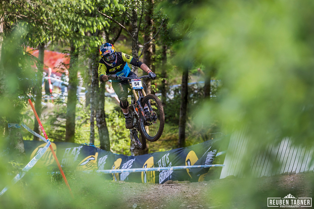 Brook MacDonald takes flight during his race run at the UCI Mountain Bike World Cup in Fort William.