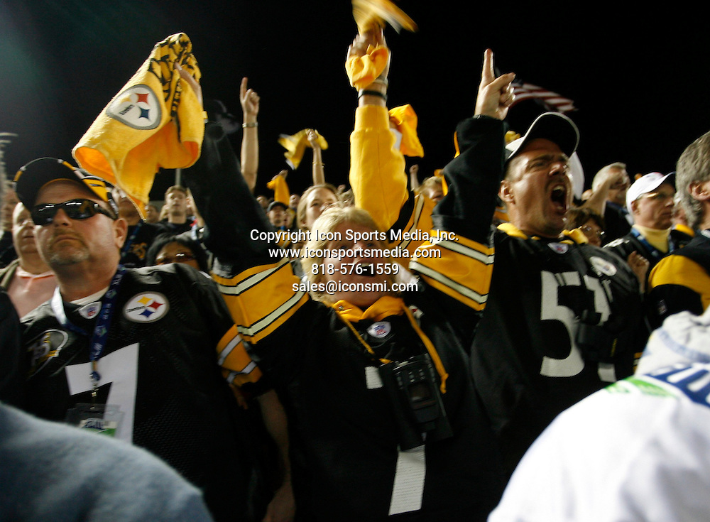 Feb 01, 2009 - Tampa, Florida, USA - Pittsburgh fans celebrate after the record-setting 100-yard touchdown run after an interception in the second quarter of Super Bowl XLIII between the Arizona Cardinals and the Pittsburgh Steelers on February 1, 2009 at Raymond James Stadium