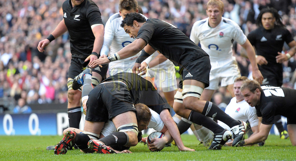Photo © TOM DWYER / SECONDS LEFT IMAGES 2010 - Rugby Union - Investec Challenge - England v New Zealand - 06/11/10 - England's Dylan Harltey barges over to score a try in the second half beating the tackle of Sam Whitelock - at Twickenham Stadium UK -  All rights reserved
