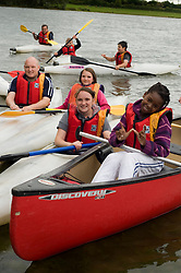Adam Bates (left) Guinness Northern Counties Youth Coordinator, with Kids from the Guinness Northern Counties Briary Close housing scheme in Wakefield Kayaking Pugneys Country Park on Thursday  26 August 2010 .Images © Paul David Drabble..