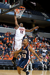 Virginia Cavaliers F Jamil Tucker (12) shoots over Carson-Newman Eagles F Zach Hyatte (00).  The Virginia Cavaliers men's basketball team defeated the Carson-Newman Eagles 124-65 in an exhibition basketball game at the John Paul Jones Arena in Charlottesville, VA on November 4, 2007.