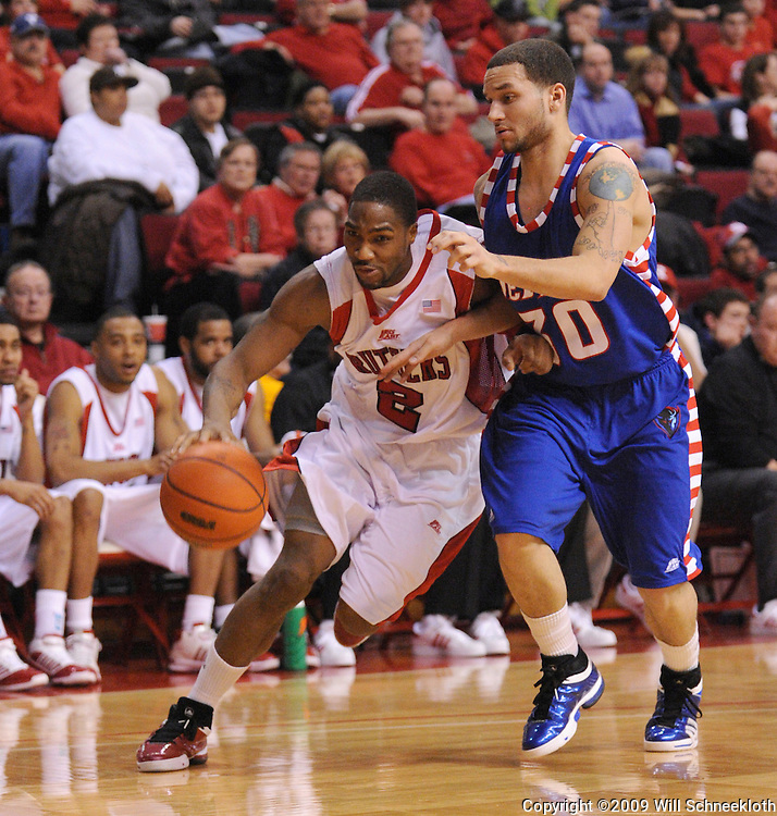 Jan 31, 2009; Piscataway, NJ, USA; Rutgers guard Anthony Farmer (2) drives around DePaul guard Will Walker (30) during the second half of Rutgers' 75-56 victory over DePaul in NCAA college basketball at the Louis Brown Athletic Center