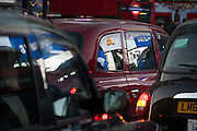 Advertising reflected in taxi windows at dusk in Piccadilly Circus, on 1st December 2016, in Piccadilly Circus, London England.