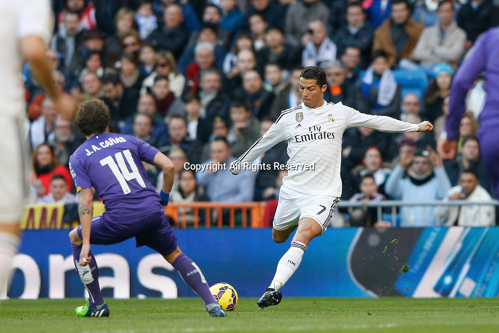 10.01.2014. Madrid, Spain.  7 Cristiano Ronaldo dos Santos Forward of Real Madrid with a shot on goal. La Liga  match played between Real Madrid versus Espanyol at Santiago Bernabeu stadium.