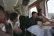 left to right...Ye Yanbing -Chinese poet, Zhang Mei-Chinese writer, Romesh Gunesekera (centre) Sri Lankan born writer, Zhang Zhe-Chinese writer, Susan Elderkin-British novelist, plotting their journey through China on a map as they travel on the 30 hour train trip between Kunming and Guangzhou as part of the Think UK Writers Train project. The Think UK China Writers Train is a project, in collaboration with the British Council, to take 4 UK writers/poets and 4 Chinese writers/poets around China by train visiting 6 major cities, in 17 days, to hold talks, seminars and readings of their work.