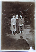 damaged vintage photo of three adult people posing 1920s