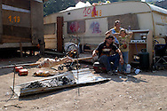 ROME May 6 2008.Rom's camp Casilino 900.Roma bosnian family cooking a lamb for lunch