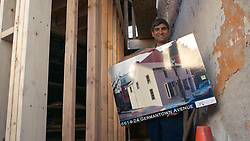 MAUSA' Executive Director Anuj Gupta shows the rendered plan of the development property as he stands on the site. (Bas Slabbers/for NewsWorks)