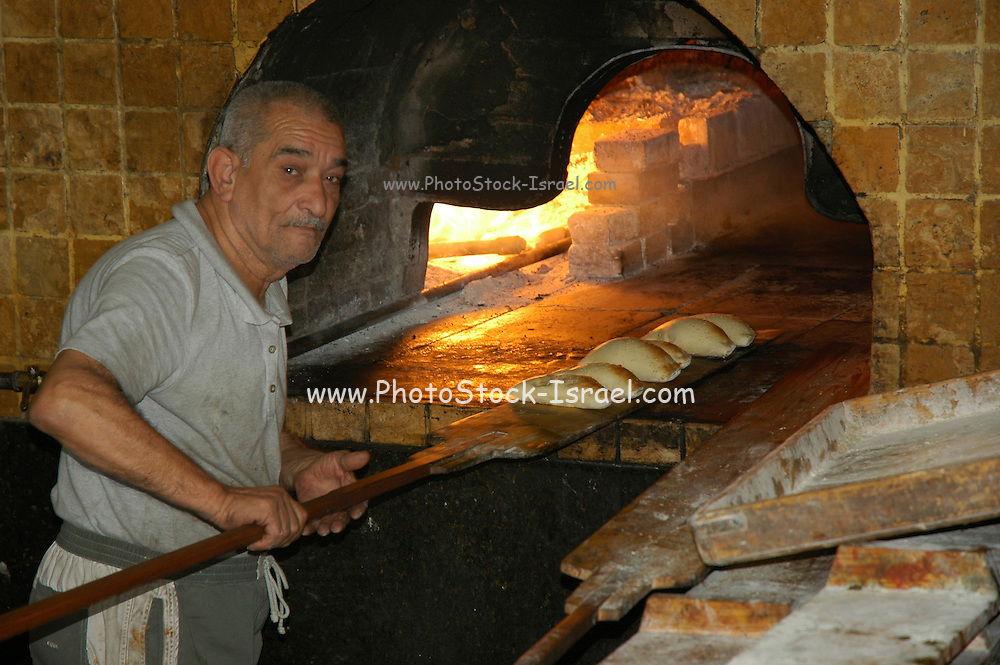 Israel, Jaffa, Baking pita in a stone oven
