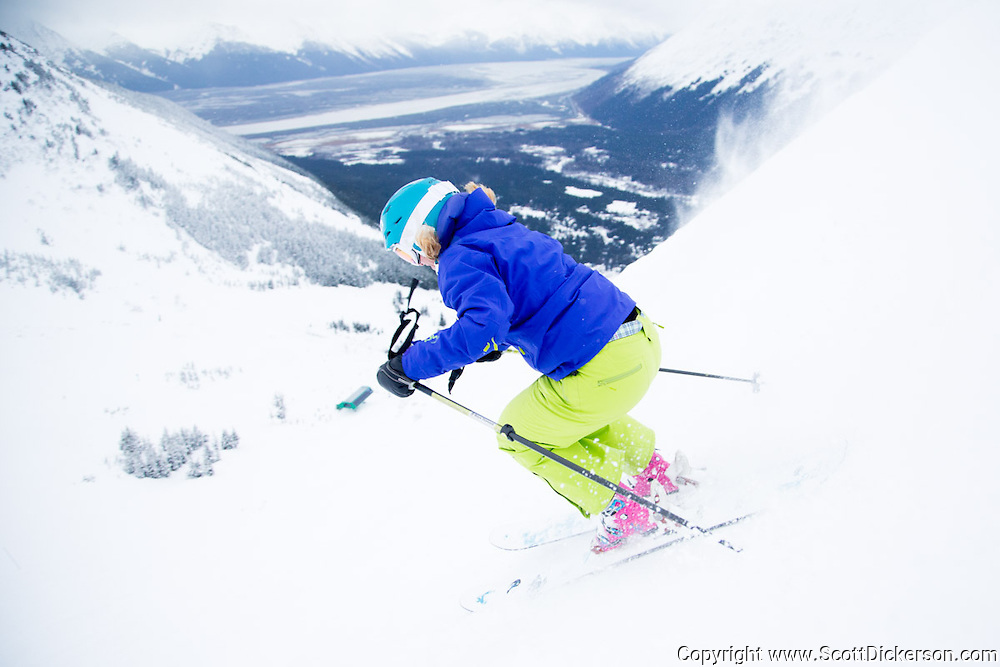 Maeve Nevins. Female skiers enjoying a day of skiing at Alyeska Resort in Girdwood, Alaska as part of the  Get the Girls Out campaign organized by SheJumps.