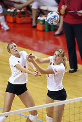 15 SEP 2009: Mallory Leggett and Angela Rego share a save. The Redbirds of Illinois State defeated the Cougars of Southern Illinois Edwardsville in 3 sets during play in the Redbird Classic on Doug Collins Court inside Redbird Arena in Normal Illinois