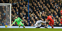LONDON, ENGLAND - Sunday, December 15, 2013: Liverpool's captain Luis Suarez scores the first goal against Tottenham Hotspur during the Premiership match at White Hart Lane. (Pic by David Rawcliffe/Propaganda)