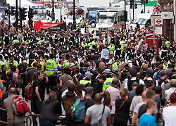 © licensed to London News Pictures. Westminster, UK  30/06/11. Hundreds of protesters were contained by police as they marched down Whitehall.  Black Bloc protesters were detained and searched under section 60 powers by officers. Thousands of demonstrators took to the streets of London to protest against proposed pension reforms for civil servants. Please see special instructions for usage rates. Photo credit should read LNP