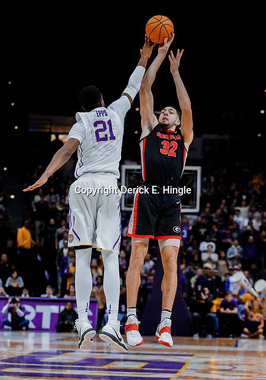 Jan 16, 2018; Baton Rouge, LA, USA; Georgia Bulldogs forward Mike Edwards (32) shoots over LSU Tigers forward Aaron Epps (21) during the first half at the Pete Maravich Assembly Center. Mandatory Credit: Derick E. Hingle-USA TODAY Sports