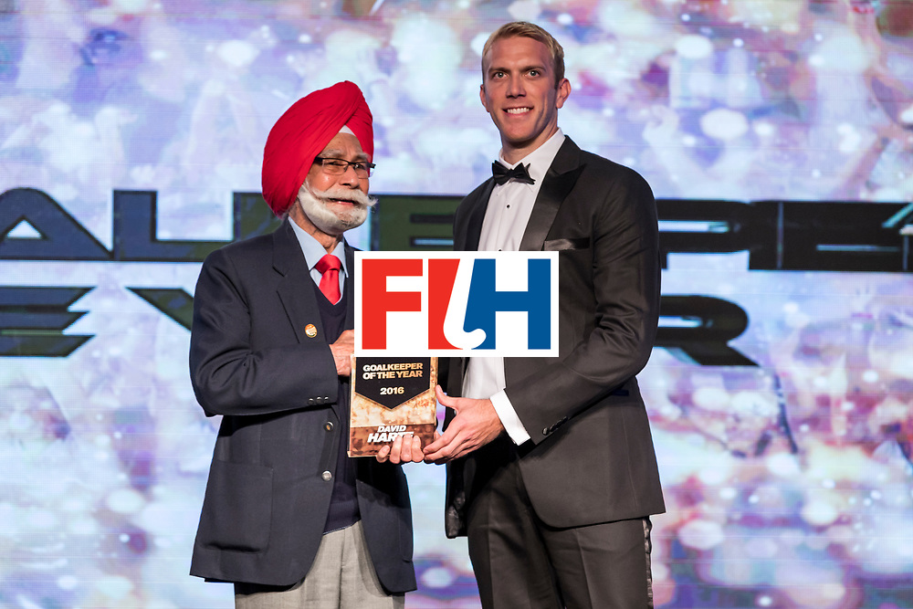 CHANDIGARH, INDIA - FEBRUARY 23: Balbir Singh [R], Three Time Olympic Gold Medalist presents the FIH Male Goal Keeper of the Year award to David Harte [R] of Ireland during the FIH Hockey Stars Awards 2016 at Lalit Hotel on February 23, 2017 in Chandigarh, India. (Photo by Ali Bharmal/Getty Images for FIH)