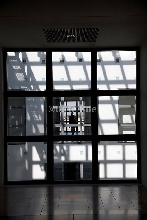 view through a window to the other side of the building with man walking