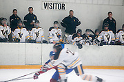 Victor coaches and players watch from the bench during a scrimmage against Fairport at Thomas Creek in Fairport on Monday, November 24, 2014.